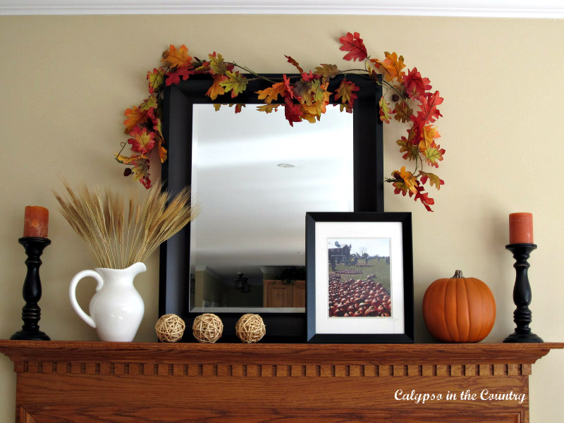 fall mantel with mirror and orange pumpkins - 3 ways to decorate a mantel for fall