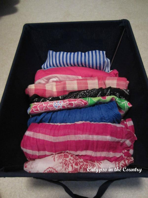 scarves in bin