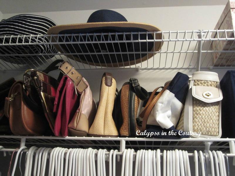 handbags on shelf closet