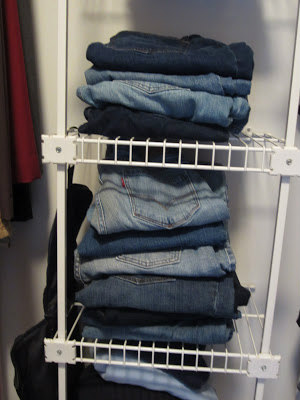 stacking jeans in closet