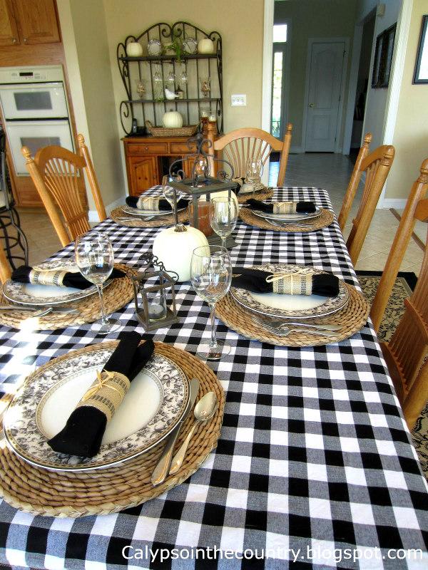 black and white buffalo checked tablecloth on farmhouse table