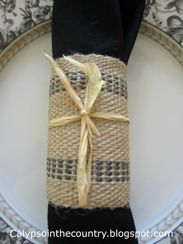 jute napkin ring on black and white plate