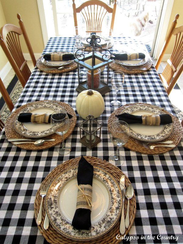 farmhouse table with black and white checked tablecloth