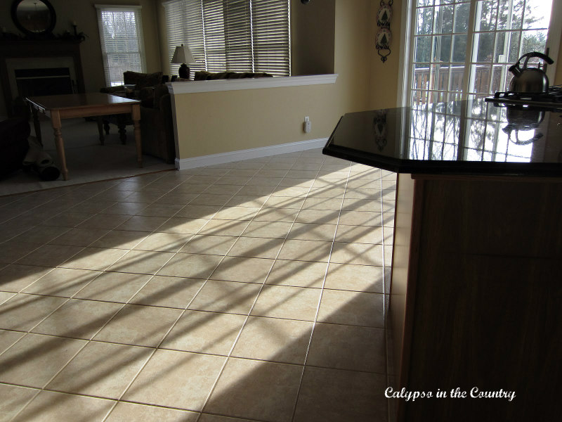 tan tile floor in sunny kitchen