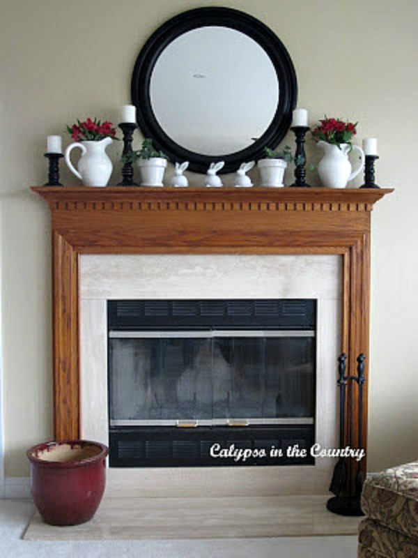 Easter mantel with flowers, white pitchers and bunnies