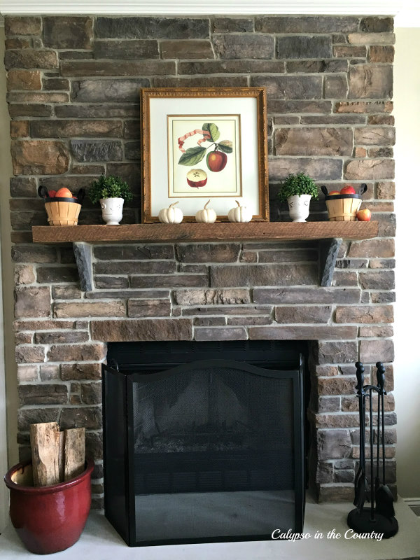 Fall Mantel with Apples and Pumpkins