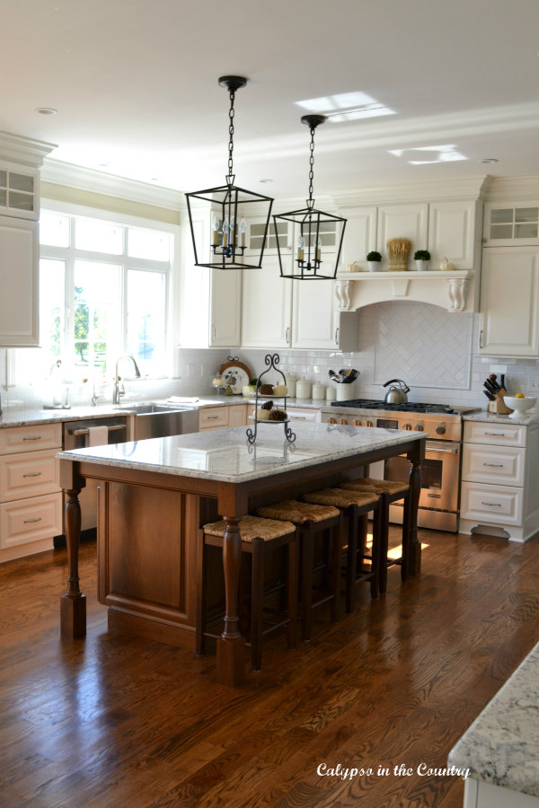white kitchen with wood stained island