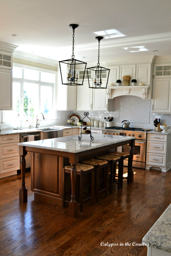white kitchen with stained wood island