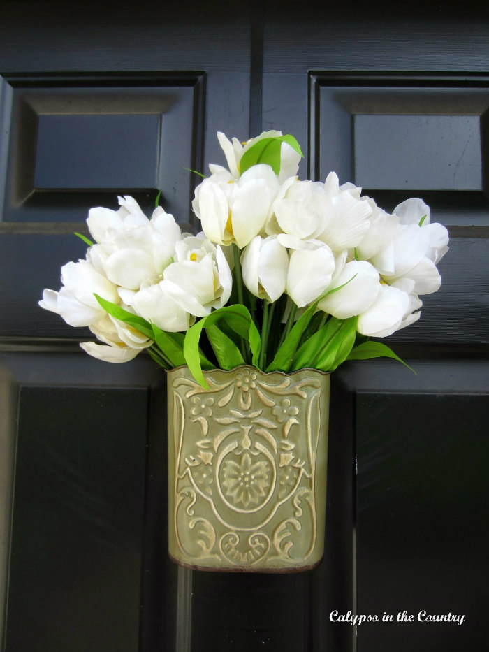 white tulips on black door