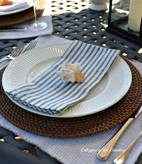 Place setting with blue and white napkin