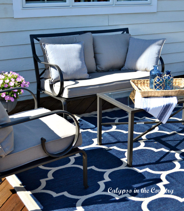 Outdoor furniture and blue rug