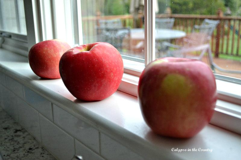 Red apples on windowsill
