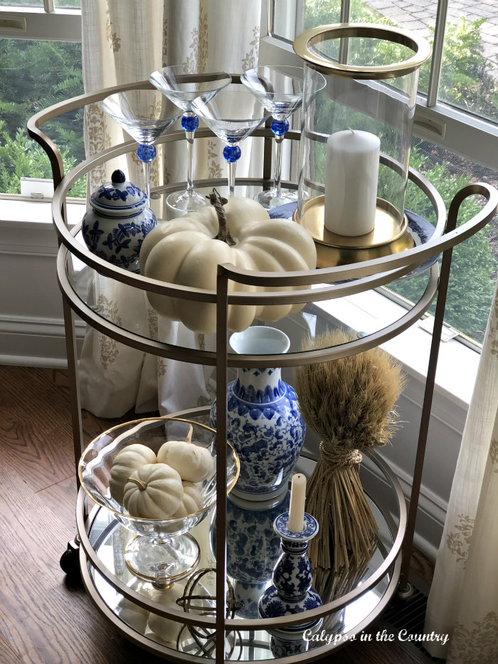 Dining Room Bar Cart Styled for Fall using blue and white accessories