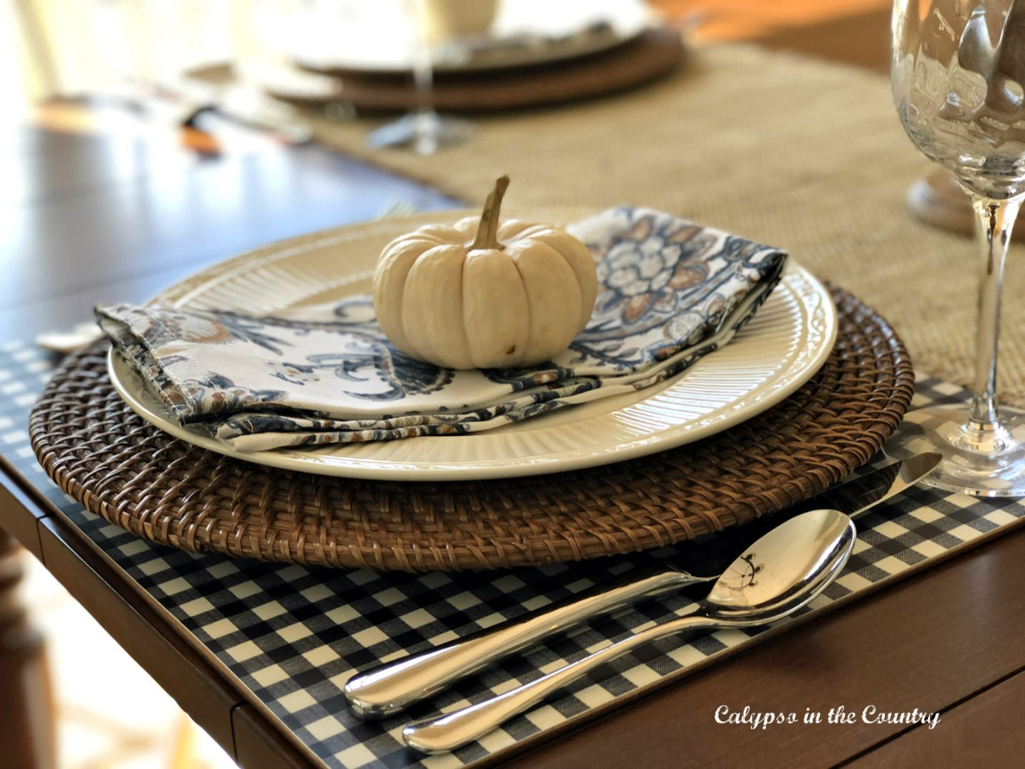 Fall place setting with white pumpkin