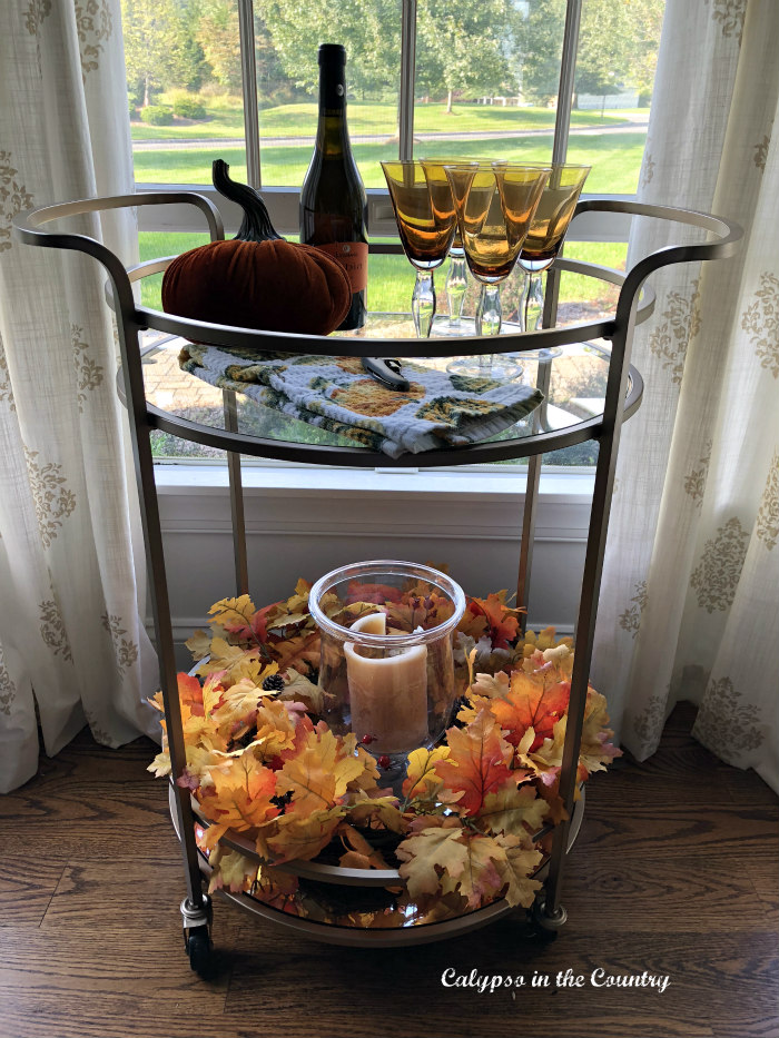 Round bar cart styled with fall colors