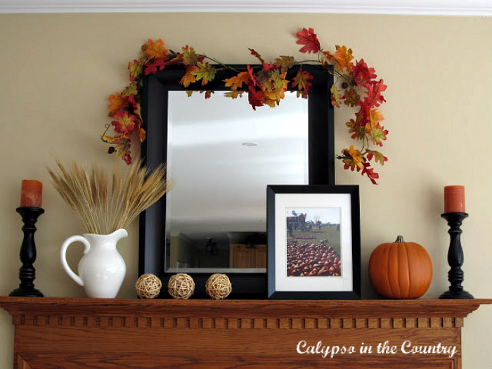Fall mantel with orange and black decor
