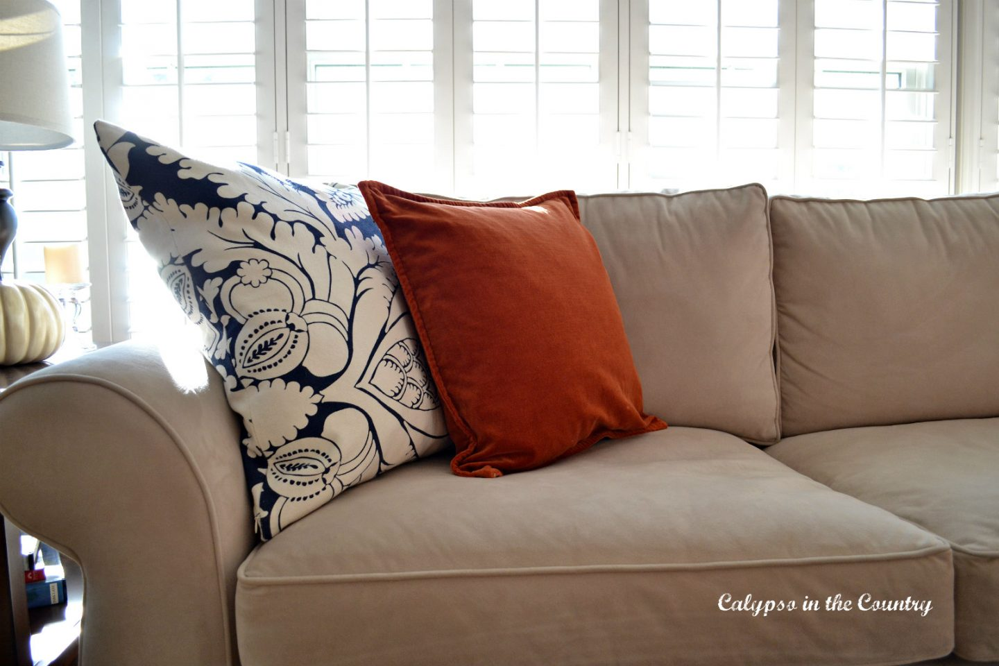 Adding orange to update pillows for fall