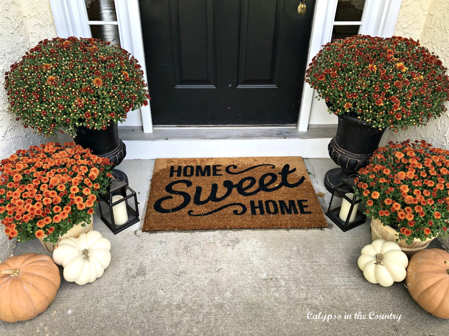 Home Sweet Home welcome mat on front porch