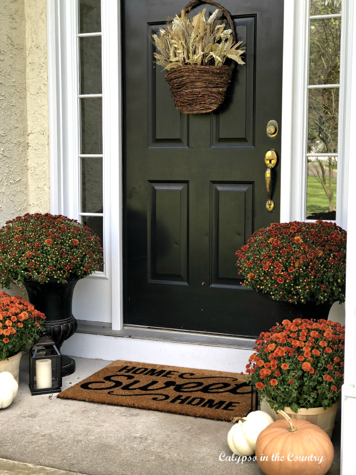 Fall front porch with orange and black