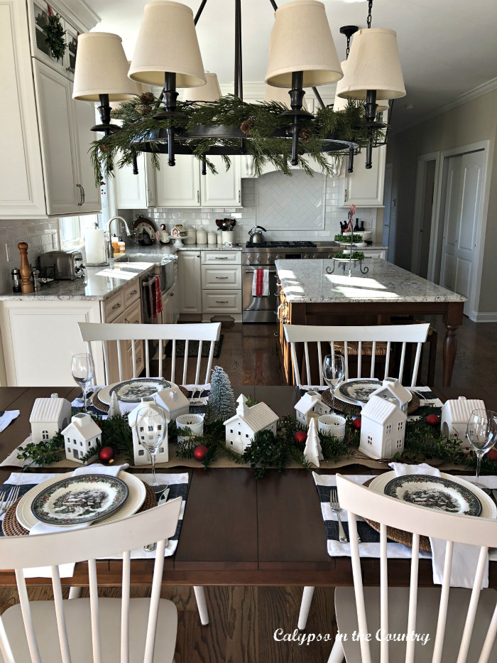 Christmas Table setting with white ceramic houses