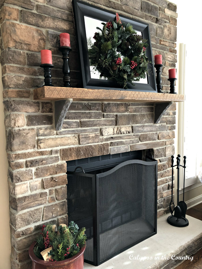 side view of stone fireplace decorated for Christmas