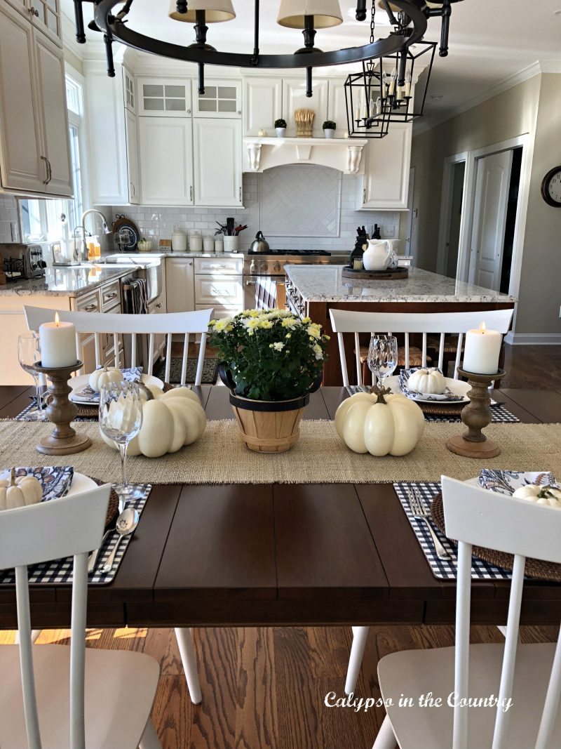 fall kitchen tablesetting with white pumpkins