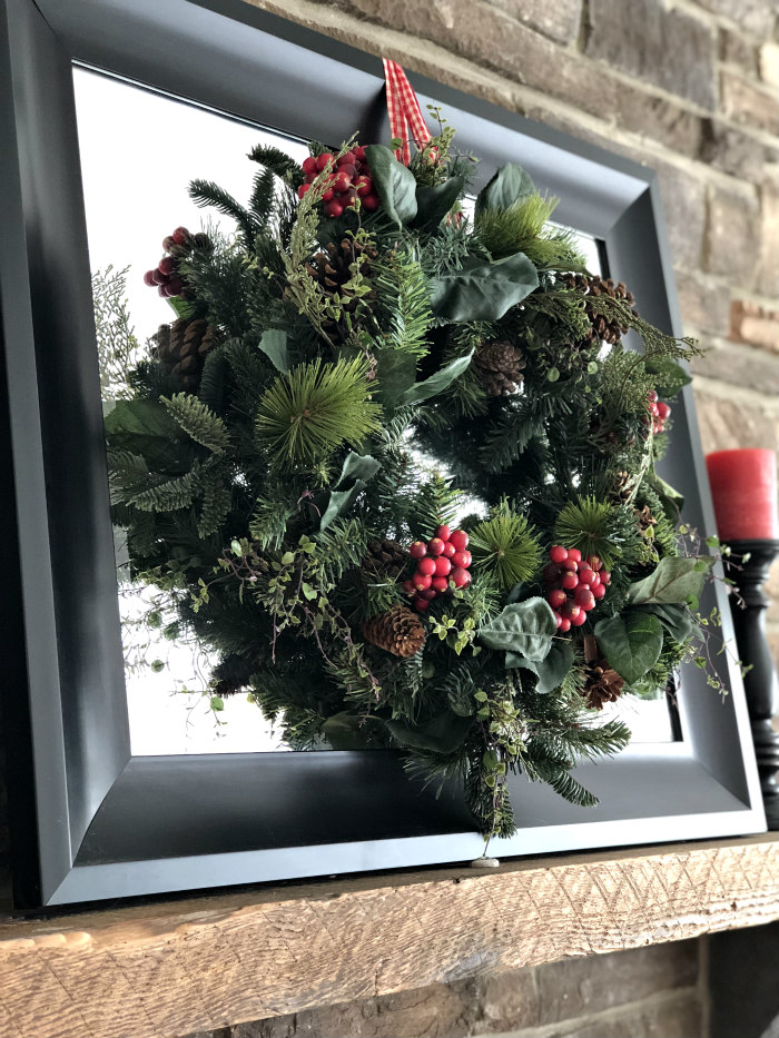 Christmas wreath on mirror