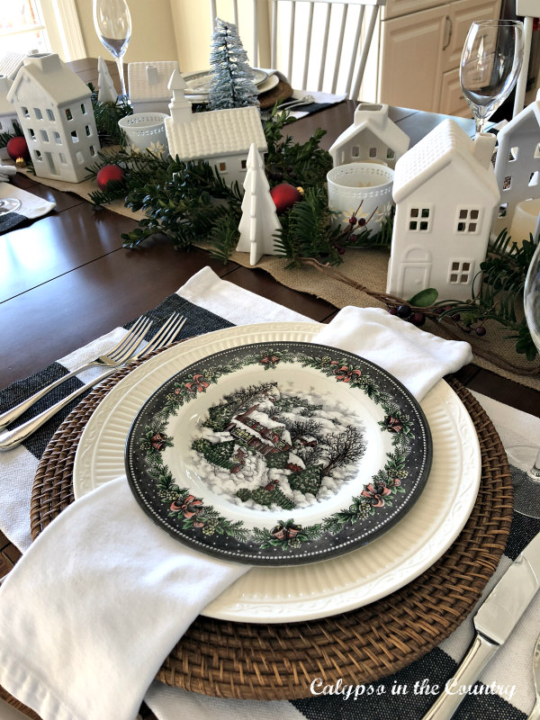 Christmas Table with White Ceramic Village and holiday plates