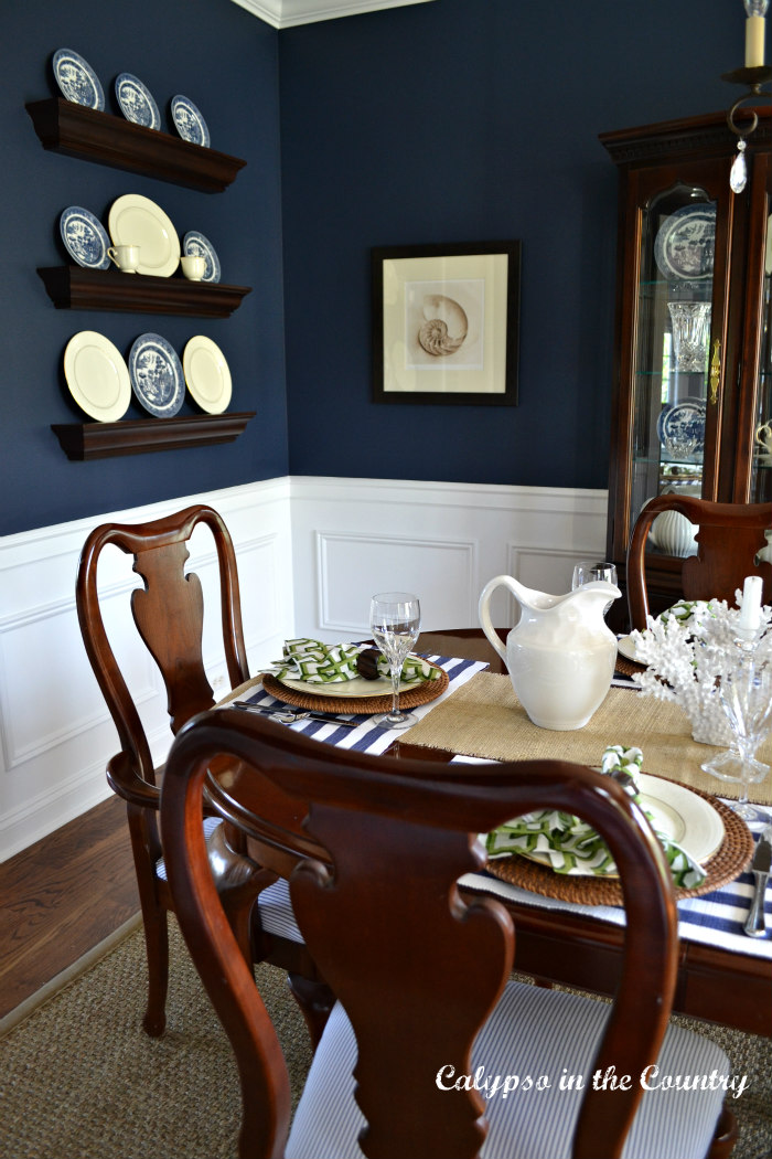 navy dining room with cherry table