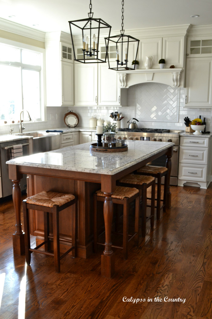 White kitchen with brown cherry island