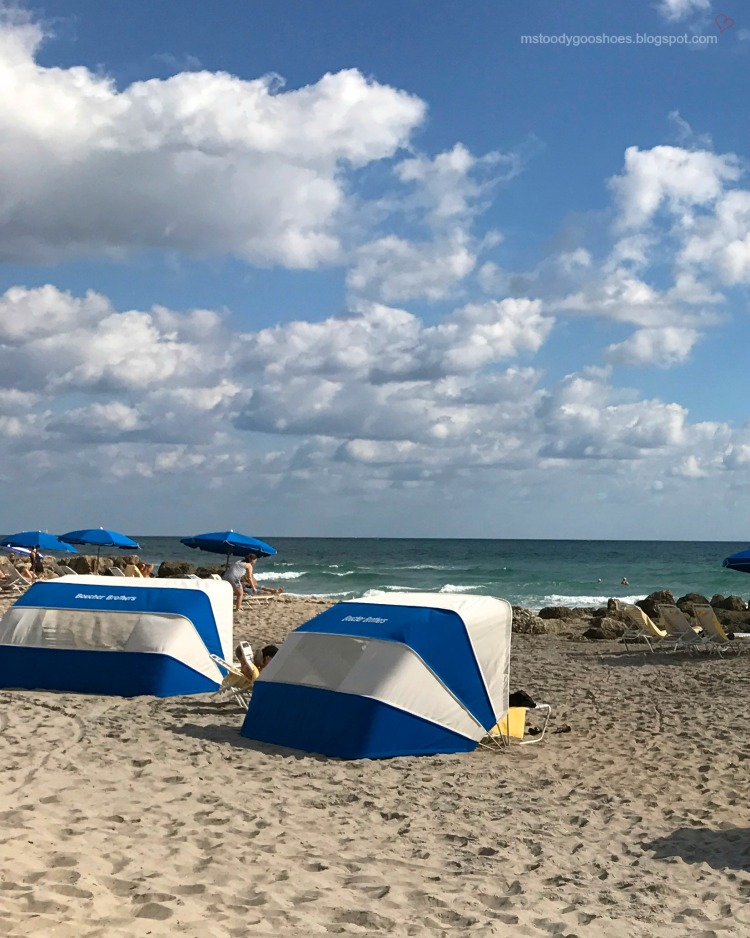 Blue and white cabanas on beach