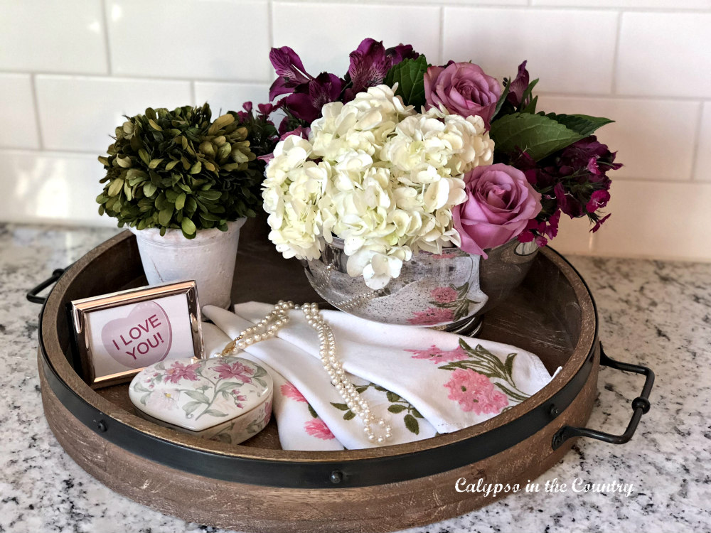 valentine accessories on round wood tray