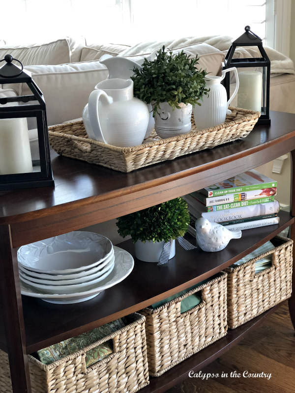 Console table with green accessories