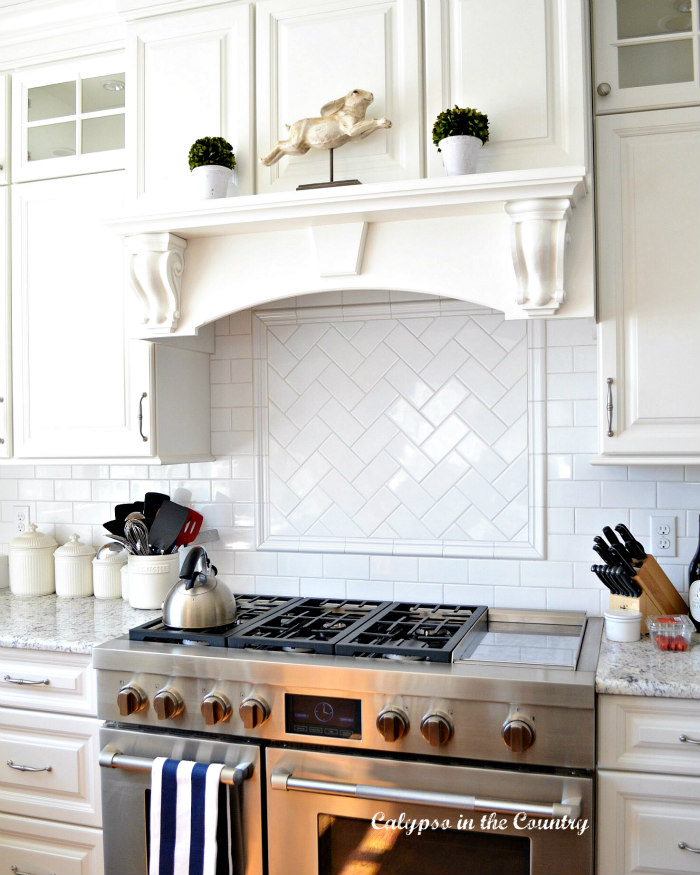 white cabinets over stove