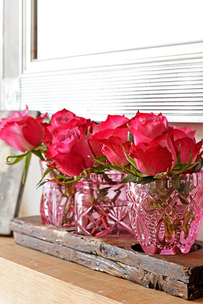 pink glass bud vases with flowers
