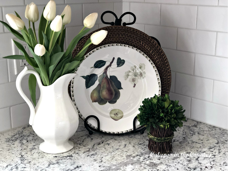fruit dish and white tulips