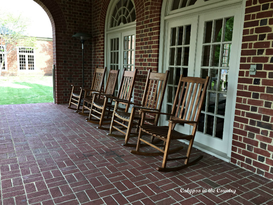 Wood Rocking Chairs on Brick porch