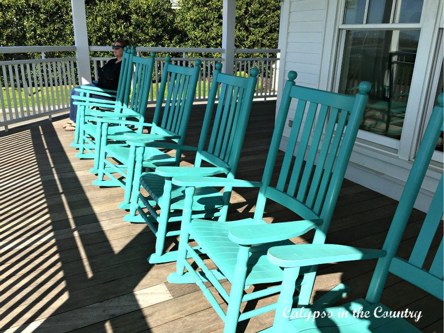 Row of Turquoise Rocking Chairs on Porch - before they changed them to white rocking chairs