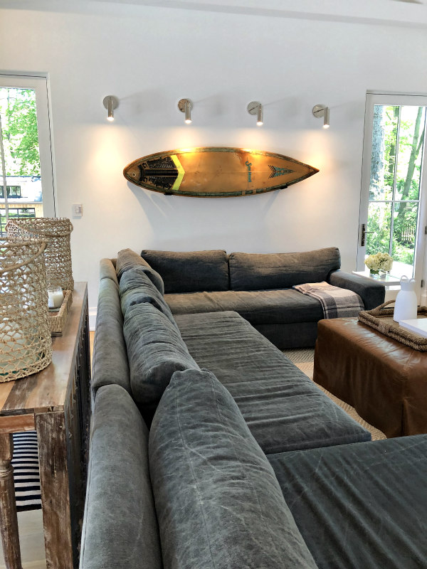 surfboard on wall in family room