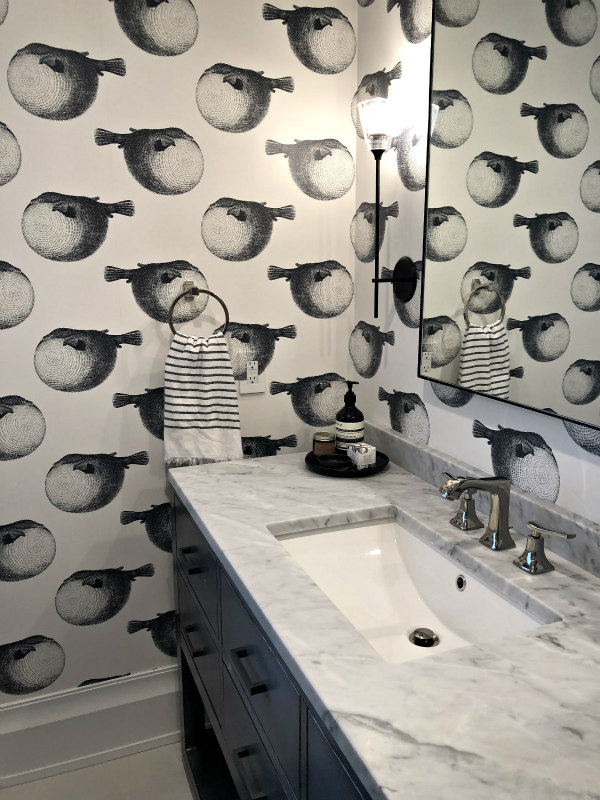 bathroom with blowfish wallpaper