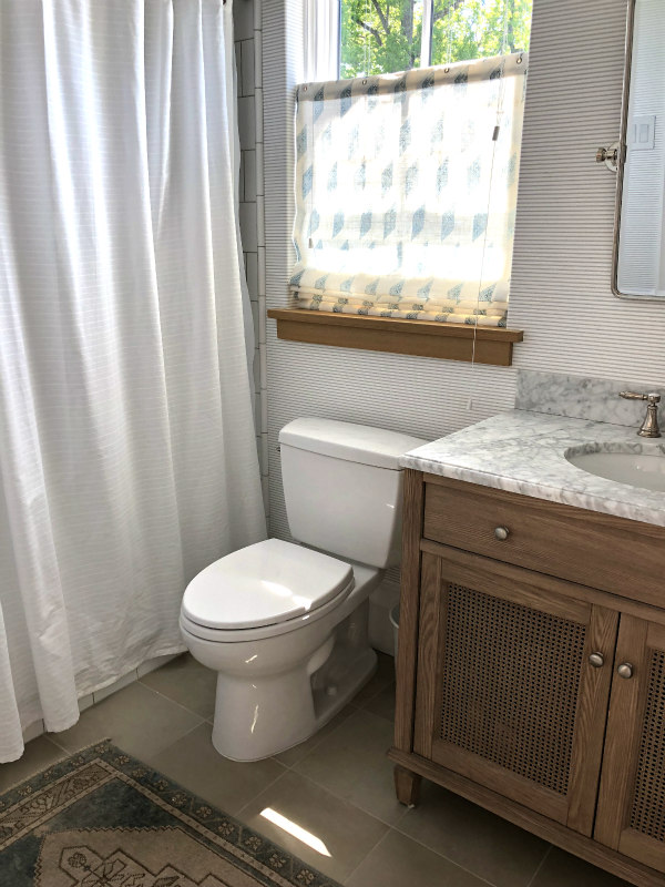 guest bath with tan and gray