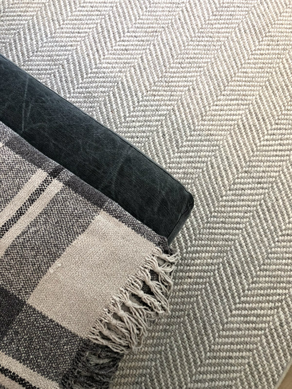 herringbone rug and plaid blanket