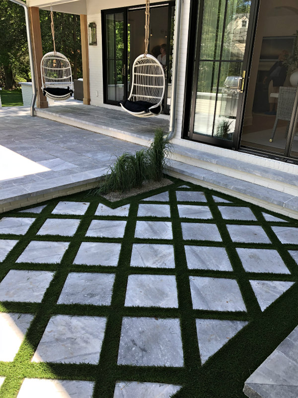 checkerboard grass and porch swings