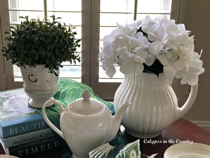 white teapot and flowers