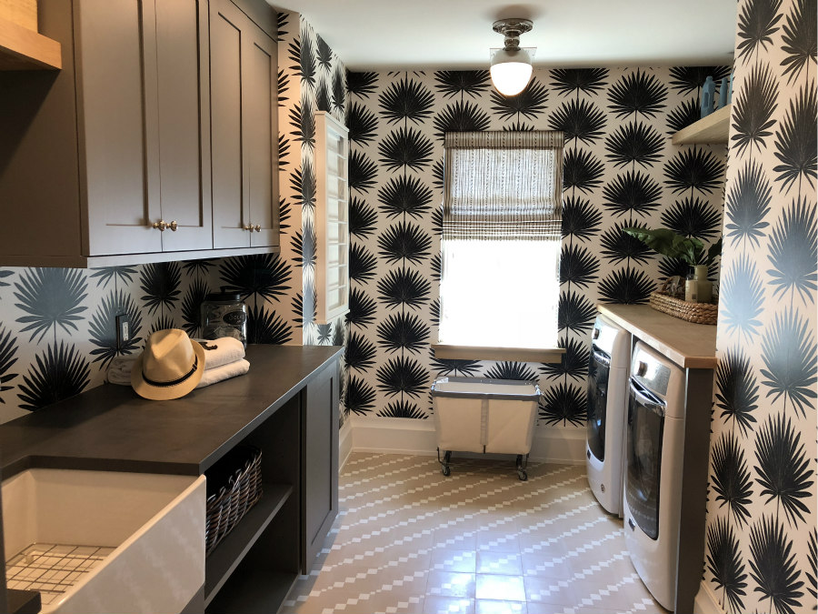 laundry room with black and white wallpaper