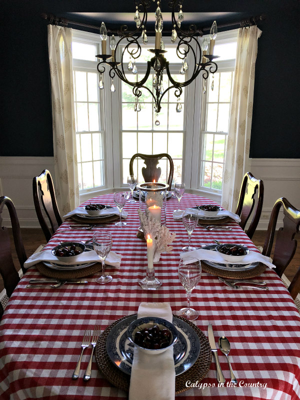 Red and White Checked Tablecloth in Navy Dining Room