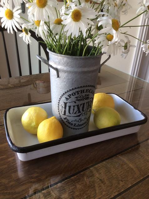 Summer vignette with galvanized flower bucket