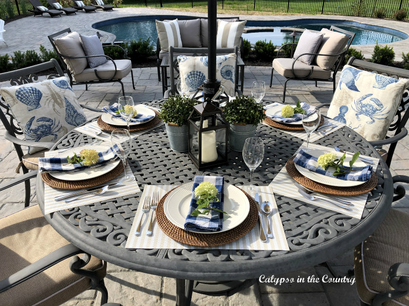 Outdoor dining table with blue and white