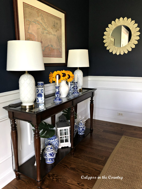 navy dining room with sunflowers