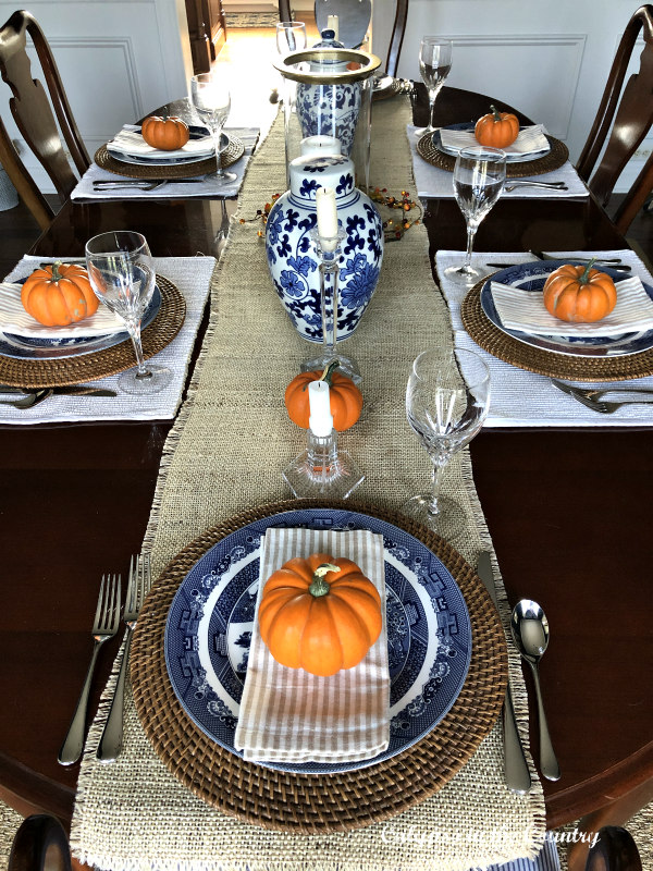 Blue and white fall tablesetting with orange pumpkins - Embracing Fall in the Dining Room